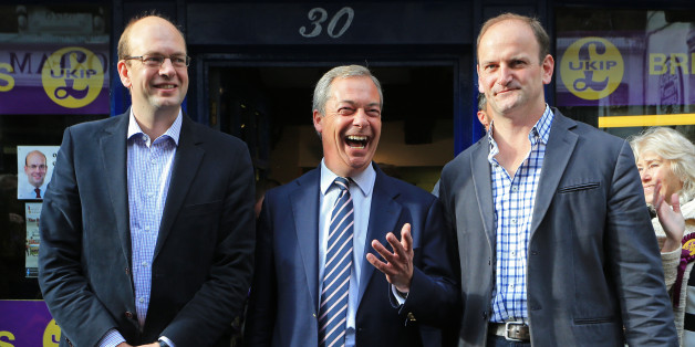 Ukip leader Nigel Farage (centre) and newly elected Ukip MP Douglas Carswell (right) joins their party's candidate Mark Reckless on Rochester High Street, Kent, as they join him on the campaign trail for the upcoming Rochester and Strood by-Election.