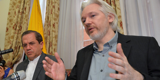 "Ecuador's Foreign Minister Ricardo Patino, left, and WikiLeaks founder Julian Assange speak during a press conference inside the Ecuadorian Embassy in London, where he confirmed he ""will be leaving the embassy soon"", Monday Aug. 18, 2014.  The Australian Assange fled to the Ecuadorian Embassy in 2012 to escape extradition to Sweden, where he is wanted over allegations of sex crimes. (AP Photo / John Stillwell, POOL)"