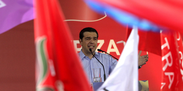ATHENS, GREECE - MAY 22:  Before the European Parliament election, Syriza party leader Alexis Tsipras speaks to crowd during his party's main election rally at Omonia square in Athens, Greece on May 22, 2014. (Photo by Ayhan Mehmet/Anadolu Agency/Getty Images)