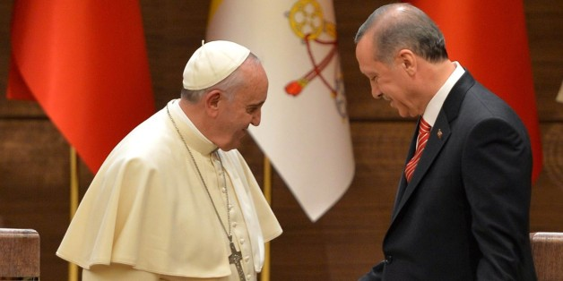 Turkish President Recep Tayyip Erdogan (R) shakes hands with Pope Francis following their joint press conference at Turkey's Presidential Palace on November 28, 2014 in Ankara. AFP PHOTO/ADEM ALTAN        (Photo credit should read ADEM ALTAN/AFP/Getty Images)