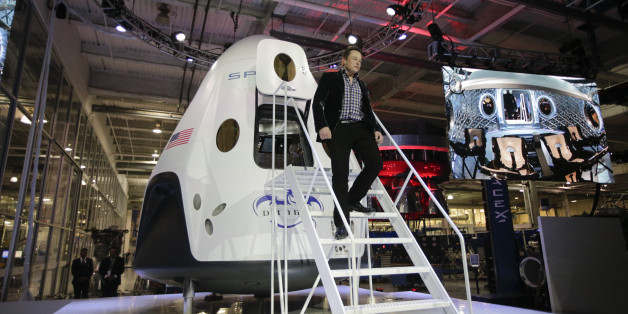 Elon Musk, CEO and CTO of SpaceX, walks down the steps while introducing the SpaceX Dragon V2 spaceship at the headquarters on Thursday, May 29, 2014, in Hawthorne, Calif. SpaceX, which has flown unmanned cargo capsules to the International Space Station, unveiled the new spacecraft Thursday designed to ferry astronauts to low-Earth orbit. (AP Photo/Jae C. Hong)