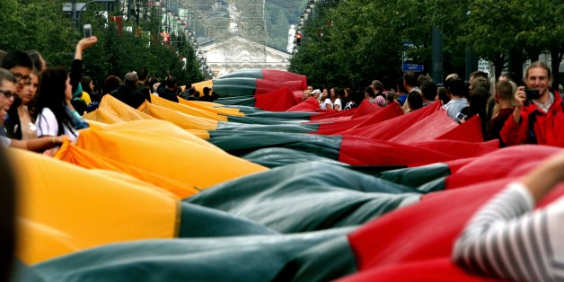 Lithuanians carry a 1000 metre long Lithuanian flag as they march during a celebration of the 25th anniversary of the Baltic Way in Vilnius on August 23, 2014. The Baltic states on Saturday marked 25 years since two million people joined hands in a landmark human chain linking up their capitals to demand freedom from the Soviet Union.  AFP PHOTO / PETRAS MALUKAS        (Photo credit should read PETRAS MALUKAS/AFP/Getty Images)