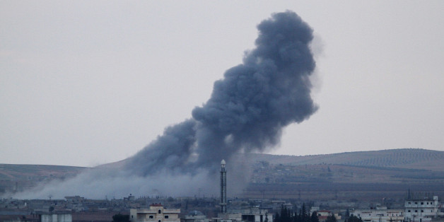 SANLIURFA, TURKEY - NOVEMBER 27: A photograph taken from Suruc district of Sanliurfa, Turkey, near Turkish-Syrian border crossing shows smoke rising from the Syrian border town of Kobani (Ayn al-Arab) following the US-led coalition airstrikes against the Islamic State of Iraq and the Levant (ISIL) targets on November 27, 2014. (Photo by Orhan Cicek/Anadolu Agency/Getty Images)