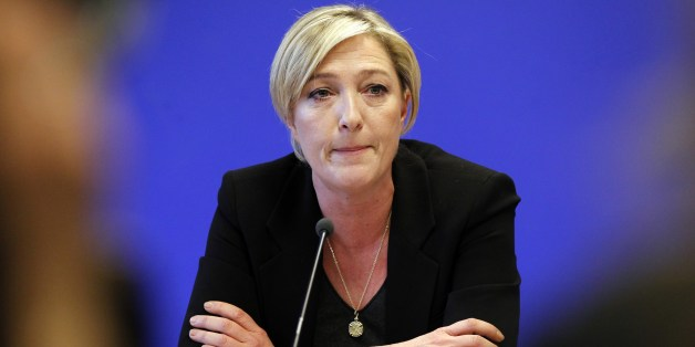 Marine Le Pen, vice-president of far-right party's Front National (FN) and daughter of FN's leader Jean-Marie Le Pen, gives a press conference in Nanterre, near Paris on December 13, 2010 at her party headquarters. Marine Le Pen is under fire after comparing Muslims praying in the streets outside overcrowded mosques in France to the Nazi occupation, during a rally of the anti-immigrant National Front on December 10. AFP PHOTO JOEL SAGET        (Photo credit should read JOEL SAGET/AFP/Getty Image