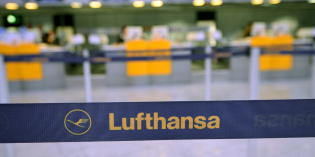 FRANKFURT AM MAIN, GERMANY - OCTOBER 21: The logo of the airline Lufthansa pictured in front of the empty counter at the Frankfurt Airport on October 21, 2014 in Frankfurt am Main, Germany. Vereinigung Cockpit, the labor union that represents the pilots, launched the two-day strike yesterday that has been expanded from short and medium-distance flights on the first day to long haul flights today, affecting over 100,000 passengers. This is the seventh strike by Lufthansa and Germanwings (a Luftha