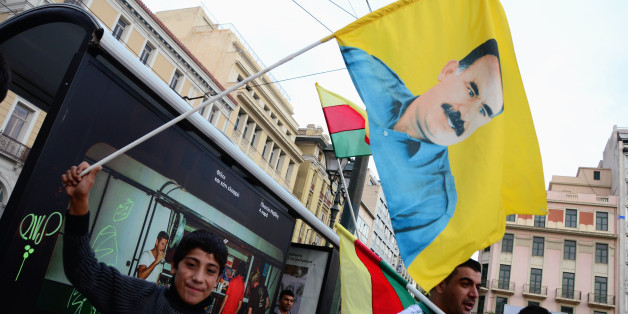 ATHENS, GREECE - 2014/10/04: A Kurdish demonstrator holds a flag with the image of Abdulah Otsalan president of PPK.  Kurdish people  living in Greece organized a demonstration in support of the Kurdish  that fight ISIS insurgents at Iraq. (Photo by George Panagakis/Pacific Press/LightRocket via Getty Images)