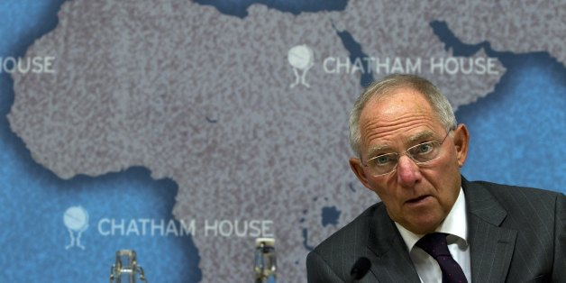 Dr Wolfgang Schäuble, Germany's Federal Minister of Finance, looks up while making a speech entitled 'Achieving Sustainable Growth: Fiscal Consolidation and Financial Market Regulation' at Chatham House, in London, on October 17, 2011. Dr Schäuble argued that governments in and beyond the eurozone need not just commit to fiscal consolidation and improved competitiveness, they need to start delivering on these objectives with immediate effect. AFP PHOTO / ADRIAN DENNIS (Photo credit should read ADRIAN DENNIS/AFP/Getty Images)