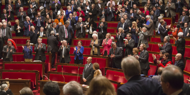 Members of French parliament, applaud after the vote for the recognition of the Palestinian State in Paris, Tuesday, Dec. 2, 2014, as opposition members leave the hall in foreground.  France's lower house of Parliament has voted to urge the government to recognize a Palestinian state, in the hope that speeds up peace efforts after decades of conflict. Tuesday's French vote, approved with 339 votes to 151, is non-binding. (AP Photo/Michel Euler)
