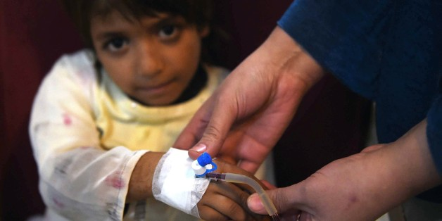 A Pakistani Thalassaemia patient receives blood at a treatment center in Peshawar on December 4, 2014.  Ten Pakistani children, from the cities of Islamabad, Rawalpindi and Lahore, have been infected with HIV after receiving tainted blood transfusions, officials said, in a 'shocking' case highlighting the abysmal state of blood screening in the country. Dr Yasmin Rashid, secretary general of the Thalassaemia Federation of Pakistan,said that it was hard to pinpoint at this stage which blood banks