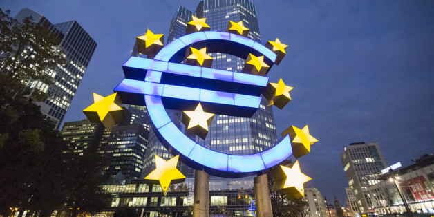 A euro sign sculpture stands illuminated in front of the European Central Bank (ECB) headquarters in Frankfurt, Germany, on Thursday, Oct. 23, 2014. At noon in Frankfurt on Oct. 26, investors will learn which of the currency bloc's 130 biggest banks fell short in the ECB's year-long examination of their asset strength and ability to withstand economic turbulence. Photographer: Martin Leissl/Bloomberg via Getty Images
