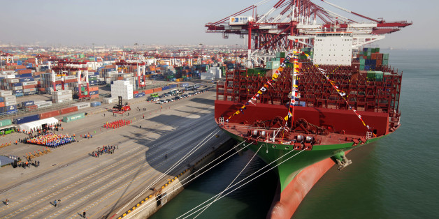 QINGDAO, CHINA - DECEMBER 04:  (CHINA OUT) The maiden voyage ceremony of the world largest container ship 'CSCL Globe' is held at Port of Qingdao on December 4, 2014 in Qingdao, Shandong province of China. The 'CSCL Globe' is the first ship co-built by China Shipping container Lines Co.,Ltd and Hyundai Heavy Industries Ltd. Co of South Korea. CSCL Globe measures 400m in length, 58.6m in width and 30.5m in depth. (Photo by ChinaFotoPress/ChinaFotoPress via Getty Images)