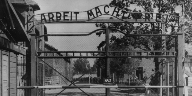 """FILE - This undated file image shows the main gate of the Nazi concentration camp Auschwitz I,  near Oswiecim , Poland, which was liberated by the Russians in January 1945. Writing  at  the gate reads: """"Arbeit macht frei"""" (Work makes free - or work liberates).  German prosecutors say they've charged a 93-year-old man with 300,000 counts of accessory to murder for serving as a guard at the Nazis' Auschwitz death camp. The charges against Oskar Groening come as part of a nationwide push against former Auschwitz guards launched last year. Unlike most of the others, Groening has openly talked about his time as a guard and says while he witnessed horrific atrocities, he did not commit any crimes himself. But Hannover prosecutors said in a statement Monday Sept. 15, 2014 he was a cog in the machinery of destruction during his time at Auschwitz in 1944, noting that he helped collect and tally money stolen from murdered inmates.  (AP Photo/File)"""