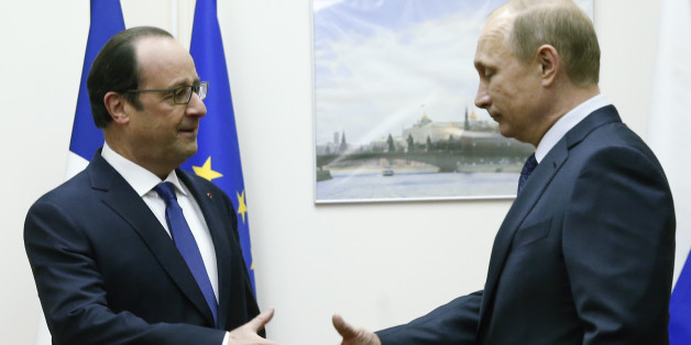 Russian President Vladimir Putin, right, approaches to shake hands with his French counterpart Francois Hollande during their meeting at Moscow's Vnukovo airport, Saturday, Dec. 6, 2014. The French leader met with Vladimir Putin at a Moscow airport on Saturday in an unexpected stopover visit, as he traveled from neighboring Kazakhstan back to Paris. (AP Photo/Maxim Zmeyev, Pool)
