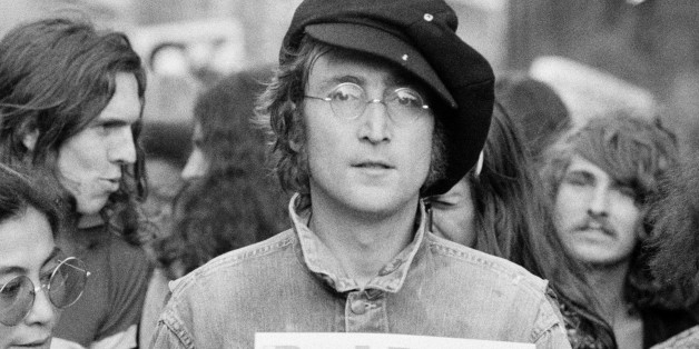 Portrait of British musician John Lennon (1940 - 1980) (center) and his wife, artist and musician Yoko Ono (extreme left) as they attend an unspecified rally in Hyde Park, London, England, 1975.  (Photo by Rowland Scherman/Getty Images)