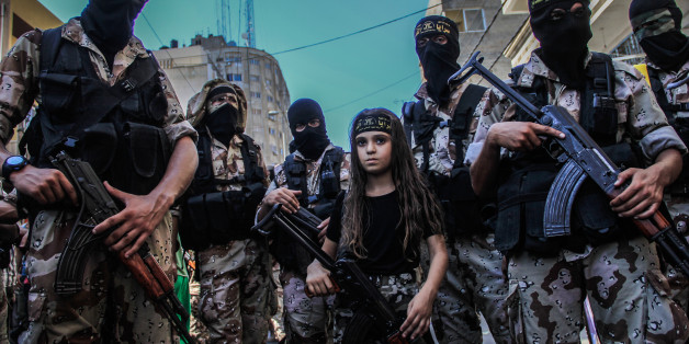 Children taking part in the military parade, which was organized by Al-Quds Brigades, the armed wing of Islamic Jihad, marking the end of the war on Gaza and what they called a victory over Israel. Gaza, Palestine, on August 29, 2014. Photo by Ibrahim Khader/Pacific Press/ABACAPRESS.COM