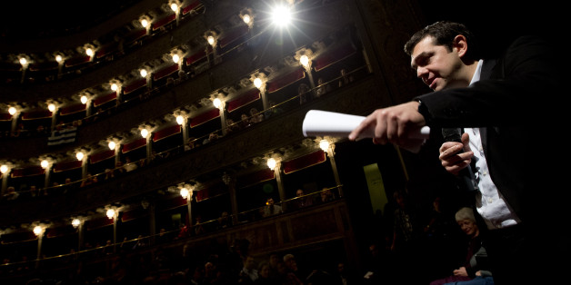 Greek leftwing opposition leader Alexis Tsipras delivers his speech during a meeting with Italian leftwing activists held at the Teatro Valle theater, in Rome, Friday, Feb.7, 2014. (AP Photo/Andrew Medichini)
