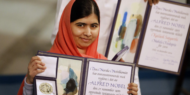 Nobel Peace Prize winners Malala Yousafzai from Pakistan, front,  and Kailash Satyarthi of India are awarded their Nobel Peace Prize during the Nobel Peace Prize award ceremony in Oslo, Norway, Wednesday, Dec. 10, 2014.  The Nobel Peace Prize is being shared between Malala Yousafzai, the 17-year-old Taliban attack survivor, and the youngest Nobel Prize winner ever, and Indian children's rights activist Kailash Satyarthi in a ceremony in Oslo on Wednesday.  (AP Photo/Matt Dunham)
