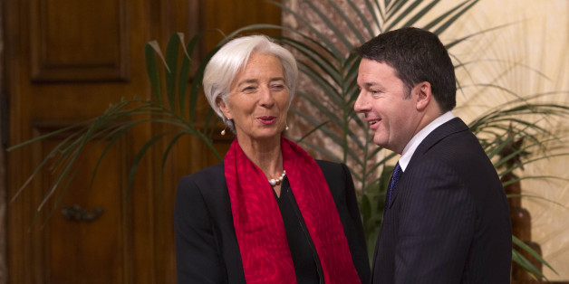 International Monetary Fund (IMF) Managing Director Christine Lagarde, left, and Italian Premier Matteo Renzi shake hands for photographers at Chigi Palace government office in Rome, Wednesday, Dec. 10, 2014. (AP Photo/Riccardo De Luca)