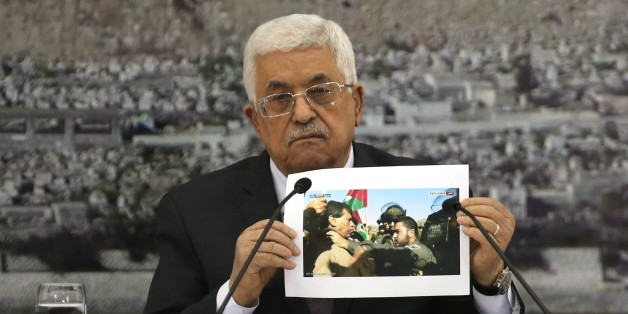 Palestinian President Mahmoud Abbas holds up a picture of senior Palestinian offical  Ziad Abu Ein a in a confrontation with an Israeli security member during a leadership meeting  in the West Bank city of Ramallah on December 10, 2014. President Abbas said all options were open for a Palestinian response to the death of Abu Ein after his confrontation with Israeli troops. AFP PHOTO / ABBAS MOMANI        (Photo credit should read ABBAS MOMANI/AFP/Getty Images)