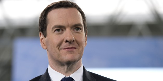 Britain's Chancellor of the Exchequer George Osborne attends the official launch of the City Football Academy in Manchester, Northern England, on December 8, 2014. AFP PHOTO / OLI SCARFFRESTRICTED TO EDITORIAL USE. No use with unauthorized audio, video, data, fixture lists, club/league logos or live services. Online in-match use limited to 45 images, no video emulation. No use in betting, games or single club/league/player publications.        (Photo credit should read OLI SCARFF/AFP/Getty Image
