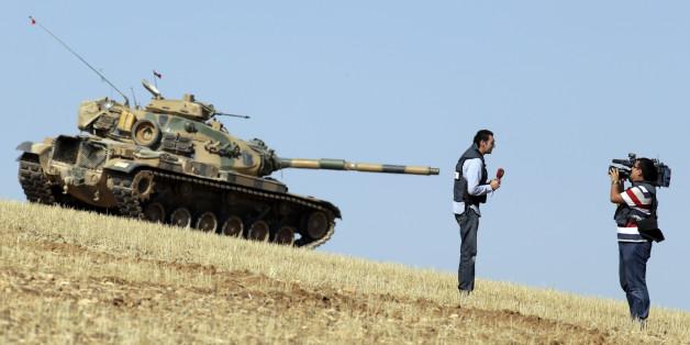 (AP Photo/Lefteris Pitarakis)