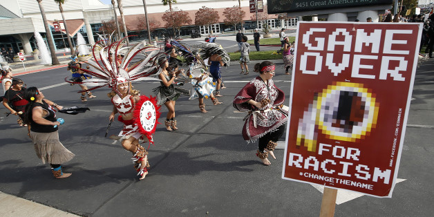 A group protests the Washington Redskins name across from Levi's Stadium before an NFL football game between the Redskins and the San Francisco 49ers in Santa Clara, Calif., Sunday, Nov. 23, 2014. (AP Photo/Tony Avelar)