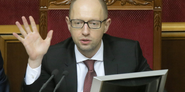 Ukrainian Prime Minister Arseniy Yatsenyuk  speaks to lawmakers during the parliament session in Kiev, Ukraine, Tuesday, Oct. 7, 2014. Parliament overwhelmingly adopted a raft of anti-corruption legislation in its first reading Tuesday and is expected to pass the laws definitively later in the month. (AP Photo/Efrem Lukatsky)