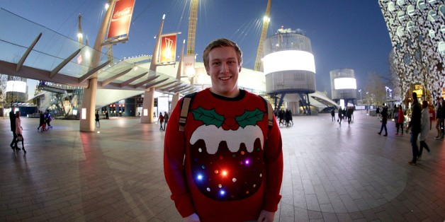 A music fan with a Christmas pudding jumper arrives for the Capital FM Jingle Bell Ball 2014 held at The O2 Arena, London