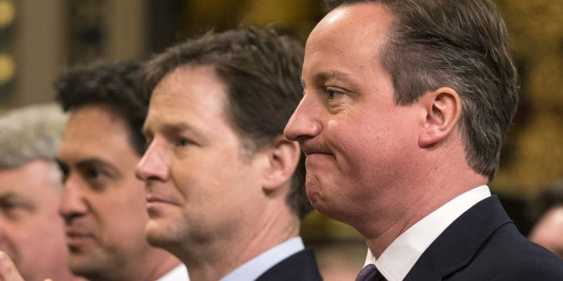 British Prime Minister, David Cameron (R), Britain's Deputy Prime Minister, Nick Clegg (2nd R) and British opposition Labour Party leader, Ed Miliband (L), react while listening to German Chancellor Angela Merkel's address to both Houses of Parliament in the Royal Gallery of the Palace of Westminster  on February 27, 2014 in London. German Chancellor Angela Merkel urged Britain Thursday to stay in the EU but played down David Cameron's hopes that her visit to London would bring major reforms. The British premier rolled out the red carpet in his bid to woo fellow conservative Merkel, who gave a speech to both houses of parliament and was due to have tea with the queen. AFP PHOTO/POOL/OLI SCARFF        (Photo credit should read OLI SCARFF/AFP/Getty Images)