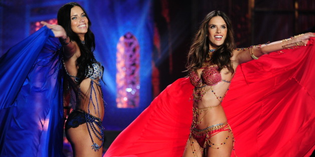 LONDON - DECEMBER 2: Models walk the runway for THE VICTORIA'S SECRET FASHION SHOW on Tuesday, Dec. 2, 2014. The show is scheduled to air Tuesday, Dec. 9, 10:00 PM ET/PT on the CBS Television Network. Pictured L-R: Adriana Lima and Alessandra Ambrosio (Photo by Heather Wines/CBS via Getty Images)