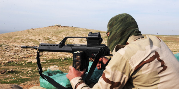 MOSUL, IRAQ - DECEMBER 09: A member of Peshmerga, the armed force of the Iraqi Kurdish Regional Government (KRG), is seen behind one of the new heavy weaponry sent by Germany and other western countries to fight against the Islamic State of Iraq and the Levant (ISIL) in the Bashiqa mountains near Mosul, Iraq on December 9, 2014. (Photo by Hamit Huseyin/Anadolu Agency/Getty Images)