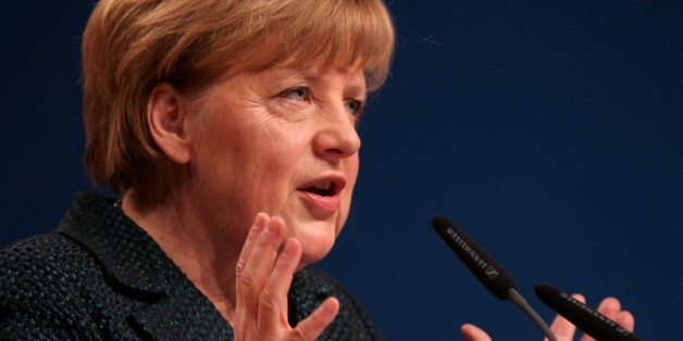 COLOGNE, GERMANY - DECEMBER 10: Germany's Chancellor and head of Christian Democratic Union (CDU) Angela Merkel gives a speech at CDU's closure session of the 27th party congress in Cologne, Germany on December 10, 2014. (Mehmet Kaman - Anadolu Agency)