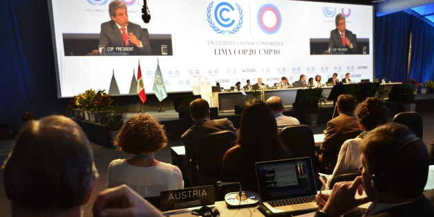 COP20 President and Peruvian Minister of Environment Manuel Pulgar (on screen) addresses representatives on December 12, 2014, during the UN COP20 and CMP10 climate change conferences being held in Lima. The UN 20th session of the Conference of the Parties on Climate Change (COP20), and the 10th session of the Conference of the Parties serving as the Meeting of the Parties to the Kyoto Protocol (CMP10) finishes on December 12. AFP PHOTO/CRIS BOURONCLE        (Photo credit should read CRIS BOURONCLE/AFP/Getty Images)
