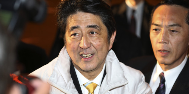 FILE - In this Dec. 13, 2014 photo, Japan's Prime Minister Shinzo Abe smiles during an election campaign for his ruling Liberal Democratic Party in Tokyo a day before Parliament's lower house election.   Japanese Prime Minister Abe's ruling party is headed for a landslide victory in lower house elections, according to projections released soon after polls closed Sunday, Dec. 14, 2014. (AP Photo/Koji Sasahara, File)