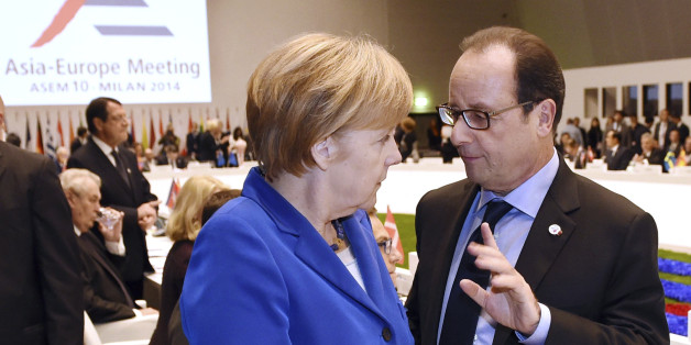 German Chancellor Angela Merkel, left, shares a word with French President Francois Hollande at the 10th Asia-Europe Meeting (ASEM) in Milan, Italy, Thursday, Oct. 16, 2014. (AP Photo/Daniel Dal Zennaro, Pool)