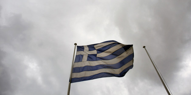 A Greek national flag flies from a pole beneath stormy skies outside the Hellenic Stock Exchange in Athens, Greece, on Wednesday, Dec. 17, 2014. Greek Prime Minister Antonis Samaras faces the first real test of sentiment among lawmakers today as he begins the process of trying to elect a new head of state. Photographer: Kostas Tsironis/Bloomberg via Getty Images
