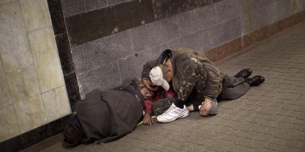 Homeless men sleep inside an underground shopping mall in central Kiev, Ukraine, Friday, Oct. 24, 2014. (AP Photo/Emilio Morenatti)