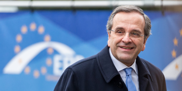 Greece's Prime Minister Antonis Samaras arrives for a meeting of EPP members ahead of an EU summit in Brussels on Thursday, Dec. 18, 2014. European Union leaders meet with the top agenda item an ambitious plan to use EU seed money and loan guarantees to jumpstart investment and revive the EU's growth and job creation rates. (AP Photo/Geert Vanden Wijngaert)