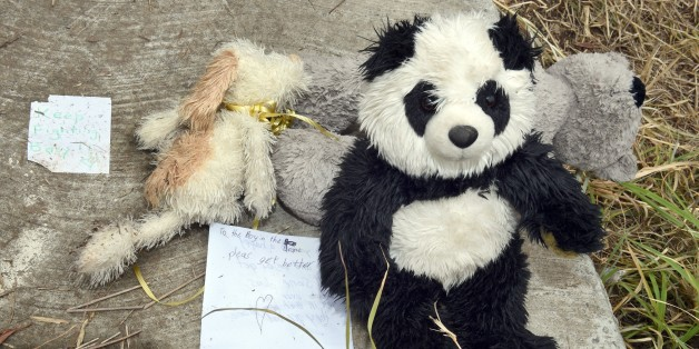 Teddy bears and notes of support are displayed on the cover of a 2.5-metre-deep (8.2-feet) deep drain in the outer Sydney suburb of Quakers Hill on November 25, 2014, following an Australian mother being charged with attempted murder after her newborn baby was found crying at the bottom of the roadside drain, where police believe he survived for five days. Passing cyclists heard wailing coming from the drain on a bike path along a western Sydney highway early morning on November 23.  AFP PHOTO / William WEST        (Photo credit should read WILLIAM WEST/AFP/Getty Images)