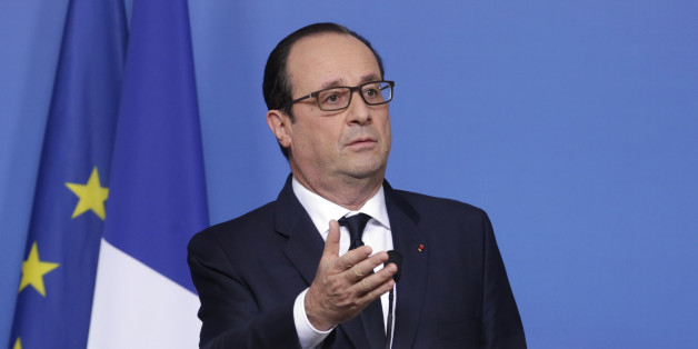 French President Francois Hollande addresses the media at the end of an EU summit at the European Council building in Brussels, Thursday, Dec. 18, 2014. European Union leaders agreed Thursday to create a strategic investment fund that could generate up to 315 billion euros ($386 billion) in private- and public-sector money to upgrade infrastructure, jumpstart the EU's sluggish economies and ignite job growth. (AP Photo/Yves Logghe)