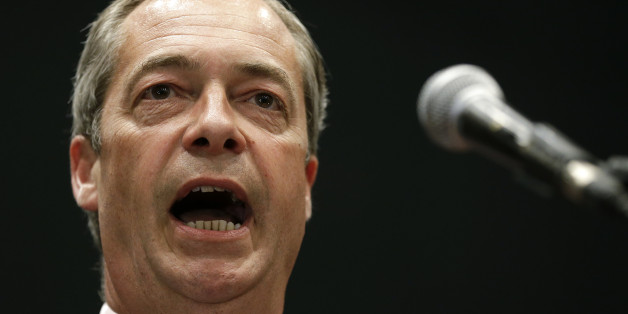"FILE - In this Monday, May 26, 2014 file photo Nigel Farage leader of Britain's UK Independence Party (UKIP) gives a speech on stage after he hears the declaration of the south east region European Parliamentary Election vote at the Guildhall in Southampton, England. "" Nigel Farage, who wants to take Britain out of the EU, has named Putin as the world leader he most admires. (AP Photo/Kirsty Wigglesworth, File)"