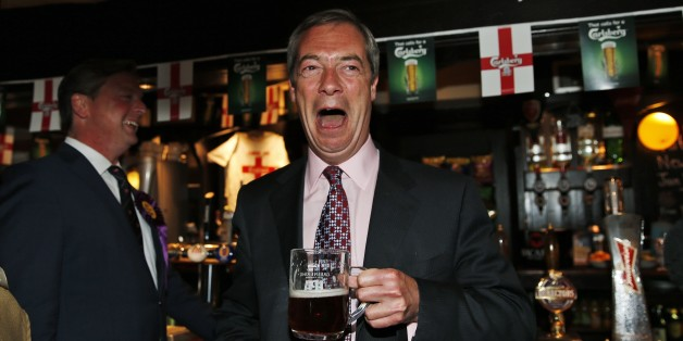 Nigel Farage, leader of Britain's United Kingdom Independence Party (UKIP) enjoys a pint of beer at a pub in South Benfleet, England, Friday, May 23, 2014.  UKIP, Britain's anti-European party has made big gains in local elections, taking votes from both the governing Conservatives and main opposition Labour Party. It's a strong performance for the U.K. Independence Party, which advocates pulling Britain out of the EU and stopping the unfettered right to entry of European citizens. With about a third of results declared Friday from voting for 161 local authorities, UKIP had almost 100 seats, well over its predicted total of 80. Britons also voted Thursday in European Parliament elections. Those results will be announced Sunday along with tallies from 27 other EU countries. (AP Photo/Lefteris Pitarakis)