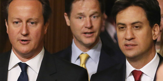 Prime Minister David Cameron (left), Deputy Prime Minister Nick Clegg (centre) and Leader of the Opposition Ed Miliband walk through the Members' Lobby before the Queen's Speech at the State Opening of Parliament in London.