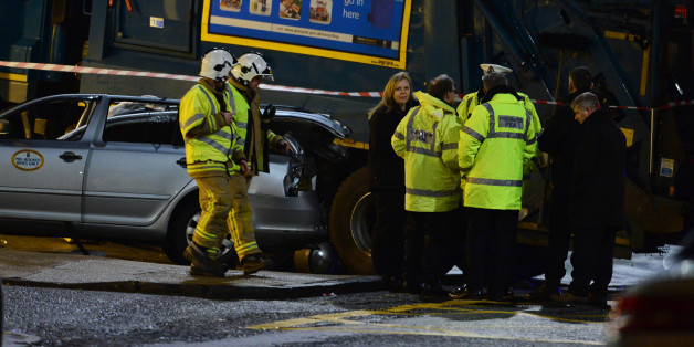 GLASGOW, SCOTLAND - DECEMBER 22:  Emergency services attend the scene of the crash in George Square on December 22, 2014 in Glasgow, Scotland. There are reports of a number of fatalities and substantial casualties after a bin lorry appears to have crashed into pedestrians in George Square.  (Photo by Mark Runnacles/Getty Images)