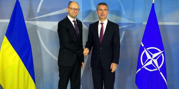 BRUSSELS, BELGIUM - DECEMBER 15: Ukraine's Prime Minister Arseniy Yatsenyuk (L) and North Atlantic Treaty Organization (NATO) Secretary General Jens Stoltenberg (R) shake hands during a joint press conference after their meeting in Brussels, Belgium on December 15, 2014. (Photo by Dursun Aydemir/Anadolu Agency/Getty Images)