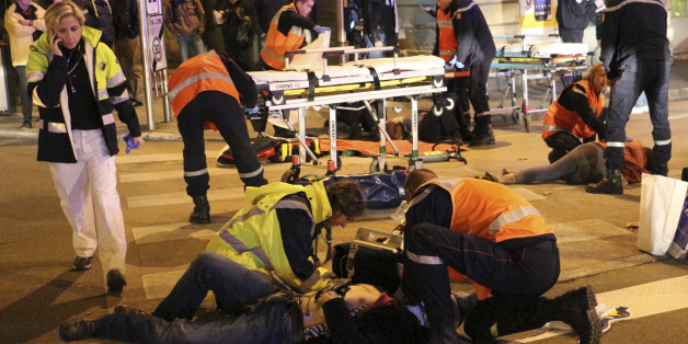 This photo provided Monday, Dec. 22, 2014 by local newspaper Le Bien Public shows rescue workers tending at victims after a driver deliberately slammed into passersby in several spots in Dijon, central France, Sunday Dec. 21, 2014. French police are raising security after an attack on officers in central France, and the country's top security official is arriving in the city where a driver ran down 11 pedestrians. (AP Photo/Christian Guileminot; Le Bien Public)
