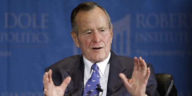 Former President George H.W. Bush answers questions the during an appearance at the University of Kansas sponsored by the Robert J. Dole Institute of Politics Sunday, Nov. 16, 2008 in Lawrence, Kan. (AP Photo/Charlie Riedel)