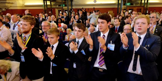 A front row of young supporters applaud as Nigel Farage, the Leader of UKIP (UK Independence Party), delivers his speech at the UKIP party conference, held at Central Hall in Westminster, London.