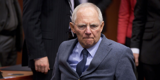 German Finance Minister Wolfgang Schaeuble arrives for a meeting of the eurogroup finance ministers at the EU Council building in Brussels on Monday, Dec. 8, 2014. (AP Photo/Virginia Mayo)