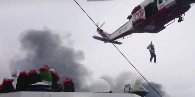 In this image taken from a Dec. 28, 2014 video and made available Wednesday, Dec. 31, 2014 a person is lifted from the deck of the Italian-flagged ferry Norman Atlantic by a rescue helicopter after it caught fire in the Adriatic Sea. More than 400 people were rescued from the ferry, most in daring, nighttime helicopter sorties that persisted despite high winds and seas, after a fire broke out before dawn Sunday on a car deck. Both Italian and Greek authorities have announced criminal investigati